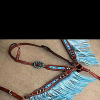13014 Medium leather headstall and breast collar set with beaded inlay and turquoise sting ray print fringe.